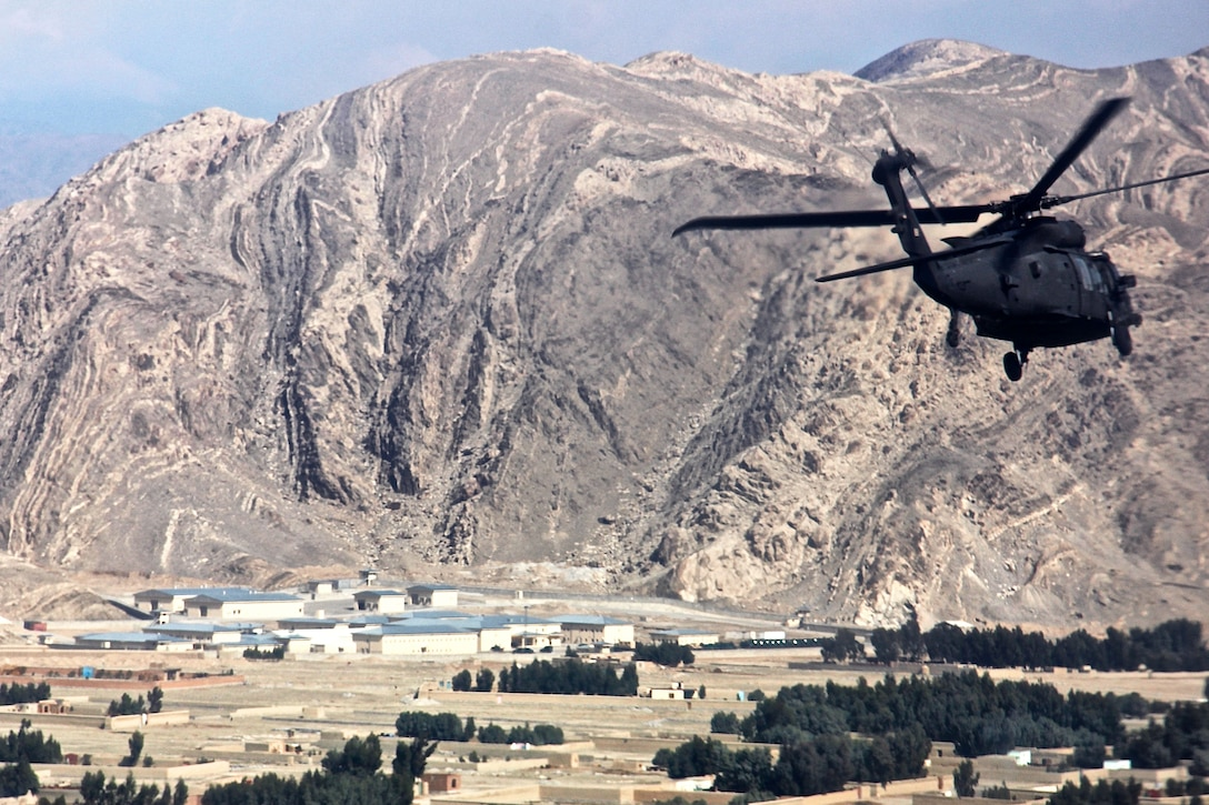 A UH-60 Black Hawk helicopter carrying U.S. leaders and advisers travels to the regional police logistics center in Nangarhar province, Afghanistan, Feb. 17, 2015. The service members are assigned to the Train, Advise, Assist Command East, Resolute Support Mission and Combined Security Transition Command Afghanistan.