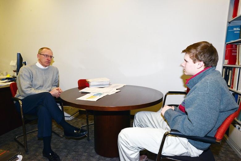 NASHVILLE, Tenn. (Feb 27, 2015) – Mike Zoccola, chief of Civil Design Branch and Construction Branch, Nashville District (right) talks with Michael Lee a sophomore student from Montgomery Bell Academy during an engineer shadow program with the U. S. Army Corps of Engineers Nashville District engineers to learn more about the jobs and educational requirements of the career field.