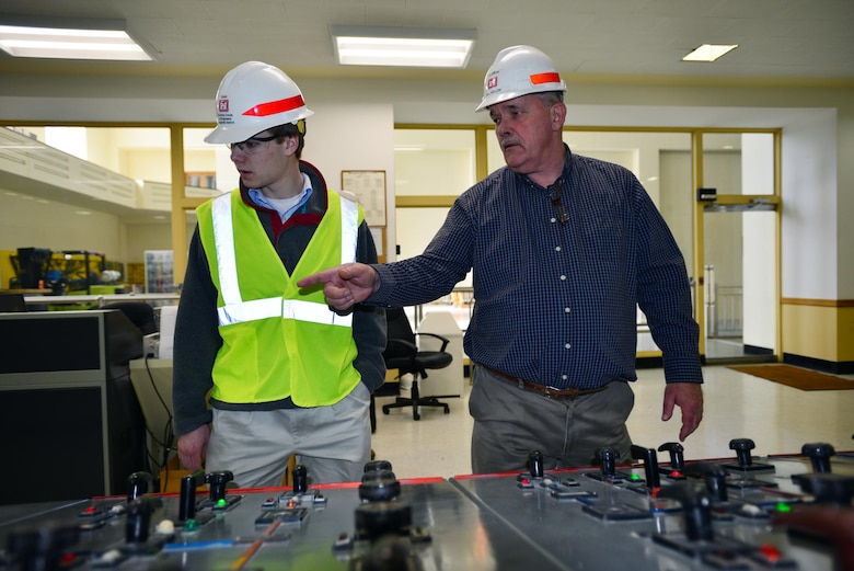 Jeff Flowers, Mid-Cumberland Power Project manager gives Michael Lee, a sophomore student from Montgomery Bell Academy a tour of the Center Hill Dam power house control room.  Lee participated in an engineer shadow program with the U.S. Army Corps of Engineers Nashville District Engineering-Construction Branch Feb. 27, 2015.