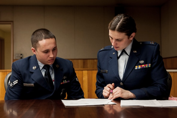 Capt. Erin Kenny (right) advises the alleged perpetrator, Airman 1st Class Adam Arruda,  during a sexual assault mock trial Feb. 24, 2015, at Kunsan Air Base, South Korea. Airmen from the Kunsan AB First Term Airmen Center have the opportunity to witness a realistic portrayal of a sexual assault trial every month. Kenny is an Area Defense Counsel attorney. (U.S. Air Force photo/Senior Airman Katrina Heikkinen)