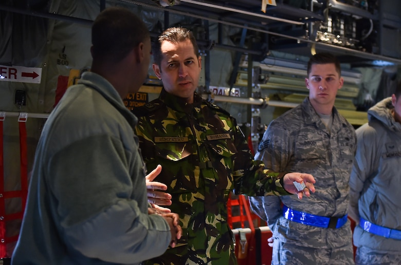 Chief Master Sgt. of the Romanian Air Force Daniel Simpetru discusses the capabilities of a C-130J Hercules with Tech. Sgt. Chris Willingham Feb. 23, 2015, at Ramstein Air Base, Germany. A group of enlisted leaders included the chief master sergeant of the Romanian and Estonian air forces and other leaders from the German, Italian, Slovenian and the U.K.'s air forces visited Ramstein AB before attending the Kaiserslautern Military Community First Sergeant Council's First Sergeant Symposium. Willingham is assigned to the 86th Aircraft Maintenance Squadron. (U.S. Air Force photo/Staff Sgt. Sara Keller)