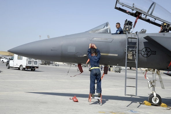 Staff Sgt Omar, top, and Staff Sgt. Jared, F-15E crew chiefs, are preparing the aircraft safe for maintenance during a post-flight inspection at an undisclosed location in Southwest Asia Feb. 25, 2015. The F-15E Strike Eagle is a dual-role fighter designed to perform air-to-air and air-to-ground missions. Both Airmen are currently deployed from Seymour Johnson Air Force Base, N.C. (U.S. Air Force photo/Tech. Sgt. Marie Brown)