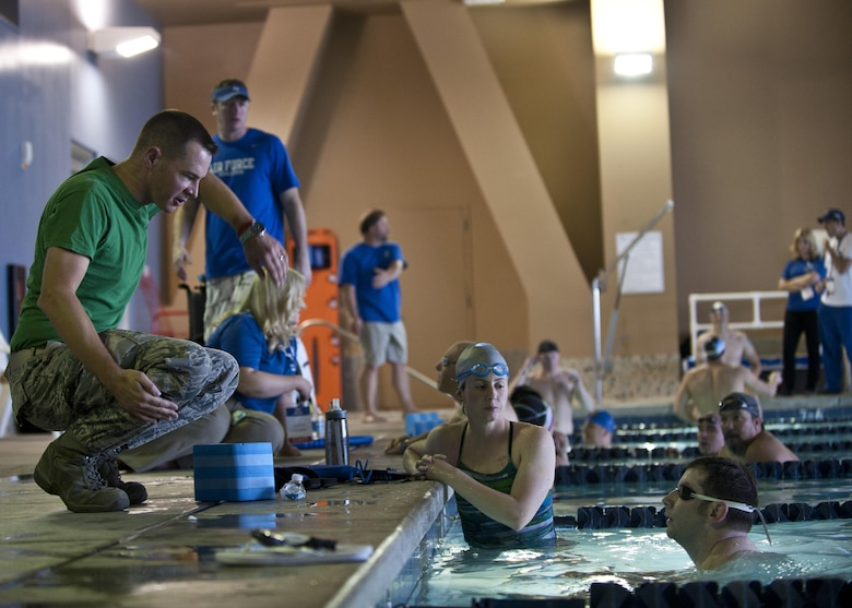 Maj. James Ross demonstrates proper arm motion Feb. 27, 2015, during a 2015 U.S. Air Force Trials swimming team practice session at Nellis Air Force Base, Nev. Ross and more than 200 members of Nellis and Creech AFBs volunteered to help out during the trials, which will run Feb. 27 to March 5. Ross is the 422nd Test and Evaluation Squadron air battle manager. (U.S. Air Force photo/Staff Sgt. Siuta B. Ika)