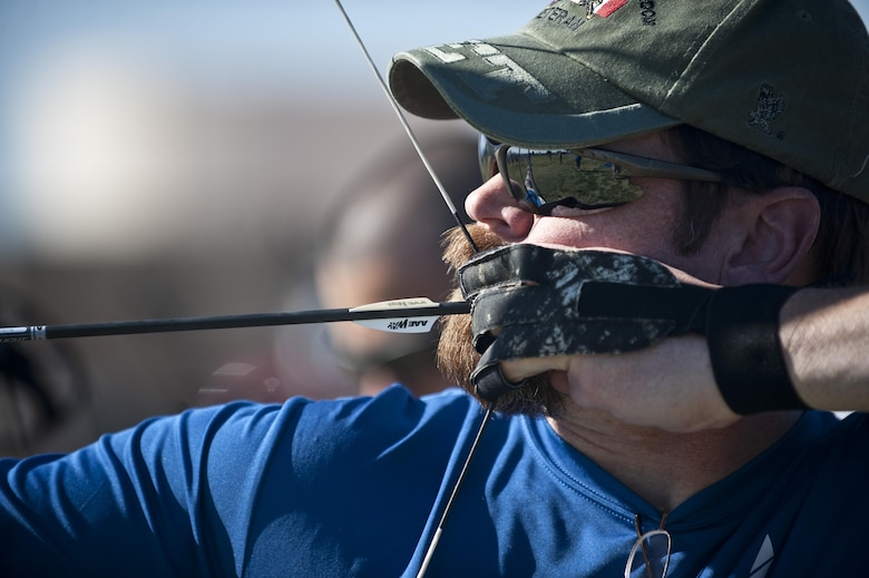 Retired U.S. Air Force Chief Master Sgt. Robert Zukauskas aims at a target during an archery practice session Feb. 27, 2015, at Nellis Air Force Base, Nev. Zukauskas suffered multiple injuries from a rocket attack during a deployment to Iraq in 2009. (U.S. Air Force photo/Staff Sgt. Siuta B. Ika)