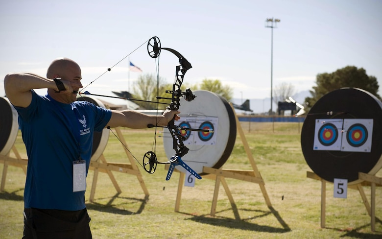 Edward Newbern aims at a target during an archery practice session Feb 26, 2015, on Nellis Air Force Base, Nev. Archery is one of 13 adaptive sports that athletes will be competing in throughout the trials. (U.S. Air Force photo/Airman 1st Class Rachel Loftis)