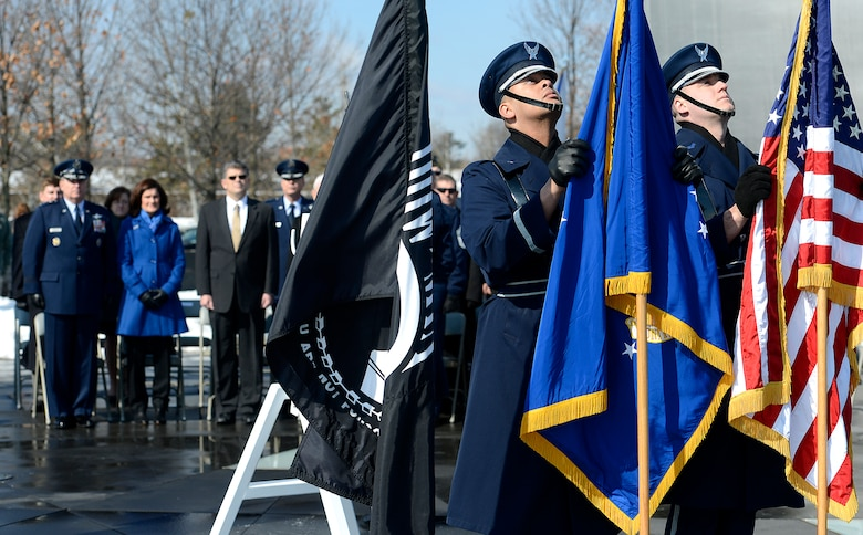 The U.S. Air Force Honor Guard posts the colors during a wreath laying ceremony March 2, 2015, hosted by Air Force Chief of Staff Gen. Mark A. Welsh III, honoring Air Force Vietnam prisoners of war and missing in action at the Air Force Memorial in Arlington, Va., March 2, 2015. (U.S. Air Force photo/Scott M. Ash)