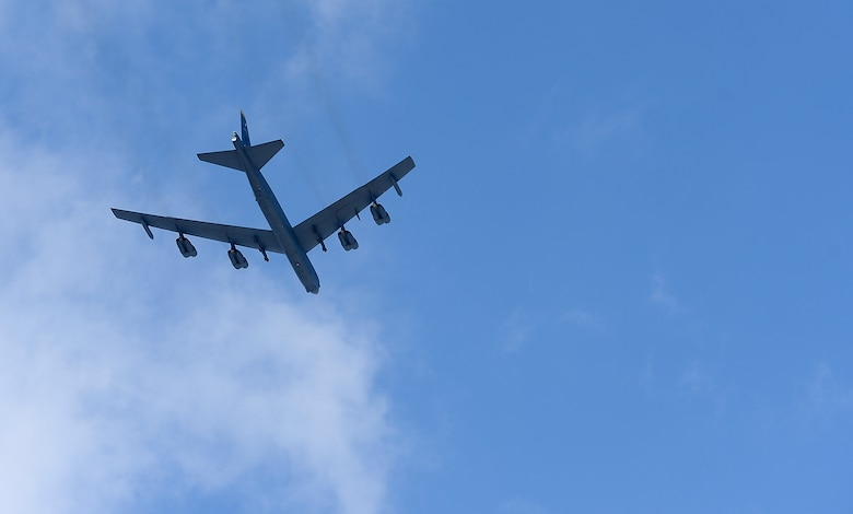 A B-52 Stratofortress flies over the Air Force Memorial during a wreath laying ceremony March 2, 2015, hosted by Air Force Chief of Staff Gen. Mark A. Welsh III, honoring Air Force Vietnam prisoners of war and missing in action in Arlington, Va. The B-52 is from the 69th Bomb Squadron at Minot Air Force Base, N.D. (U.S. Air Force photo/Scott M. Ash)