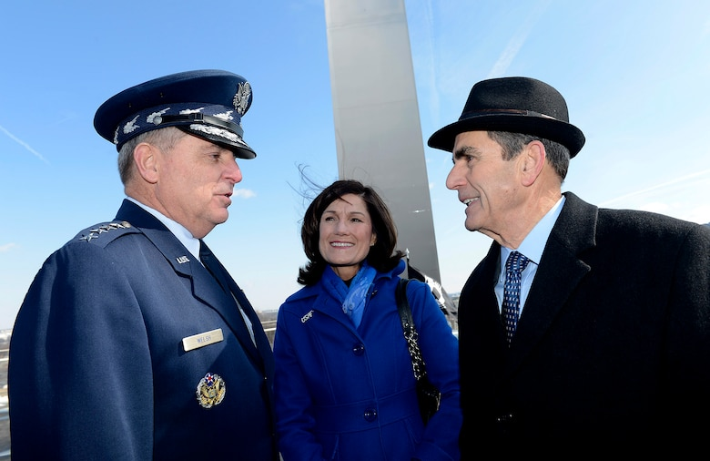 "Air Force Chief of Staff Gen. Mark A. Welsh III and his wife, Betty, speak with retired Col. Leon F. ""Lee"" Ellis, a former Air Force prisoner of war, following a wreath laying ceremony March 2, 2015, at the Air Force Memorial in Arlington, Va. The ceremony honored Air Force Vietnam POWs and missing in action. (U.S. Air Force photo/Scott M. Ash)"