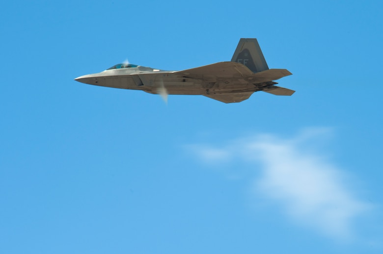 An F-22 Raptor flies during the 2015 Heritage Flight Training and Certification Course at Davis-Monthan Air Force Base, Ariz., March 1, 2015.  Established in 1997, the HFTCC featured aerial demonstrations from historical and modern fighter aircraft which will fly in formation together during air shows across the country. (U.S. Air Force photo by Airman 1st Class Chris Massey/Released)