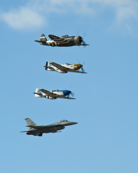A P-47 Thunderbolt, two P-51 Mustangs and F-16 Fighting Falcon fly in formation during the 2015 Heritage Flight Training and Certification Course at Davis-Monthan Air Force Base, Ariz., Feb. 28, 2015.  The annual aerial demonstration training event has been held at D-M since 2001, providing civilian and military pilots the opportunity to practice flying in formation for the upcoming air show season. (U.S. Air Force photo by Airman 1st Class Chris Massey/Released)