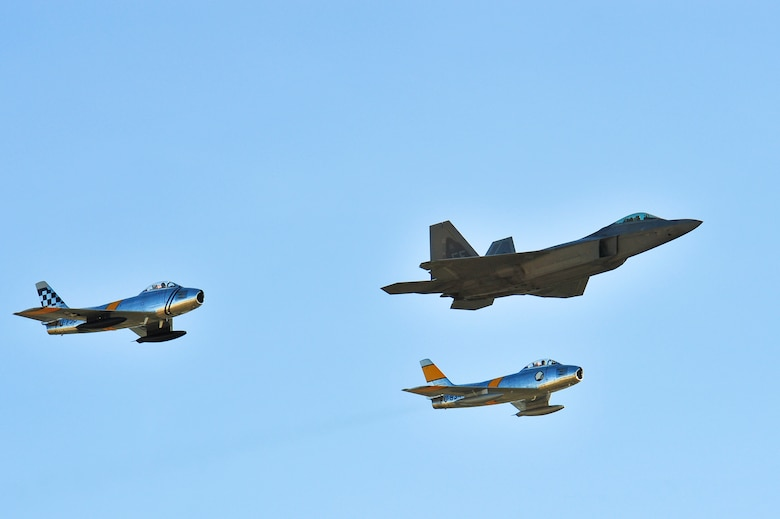 Two F-86 Sabres and an F-22 Raptor fly in formation during the 2015 Heritage Flight Training and Certification Course at Davis-Monthan Air Force Base, Ariz., Feb. 27, 2015. Established in 1997, the HFTCC featured aerial demonstrations from historical and modern fighter aircraft which will fly in formation together during air shows across the country. (U.S. Air Force photo by Airman 1st Class Chris Massey/Released)