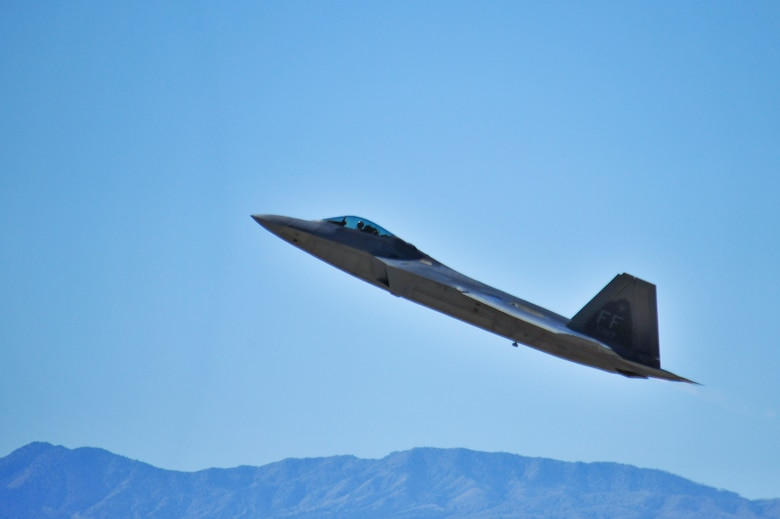 An F-22 Raptor performs and aerial maneuver during the 2015 Heritage Flight Training and Certification Course at Davis-Monthan Air Force Base, Ariz., Feb. 26, 2015. The annual aerial demonstration training event has been held at D-M since 2001, providing civilian and military pilots the opportunity to practice flying in formation for the upcoming air show season. (U.S. Air Force photo by Airman 1st Class Chris Massey/Released)