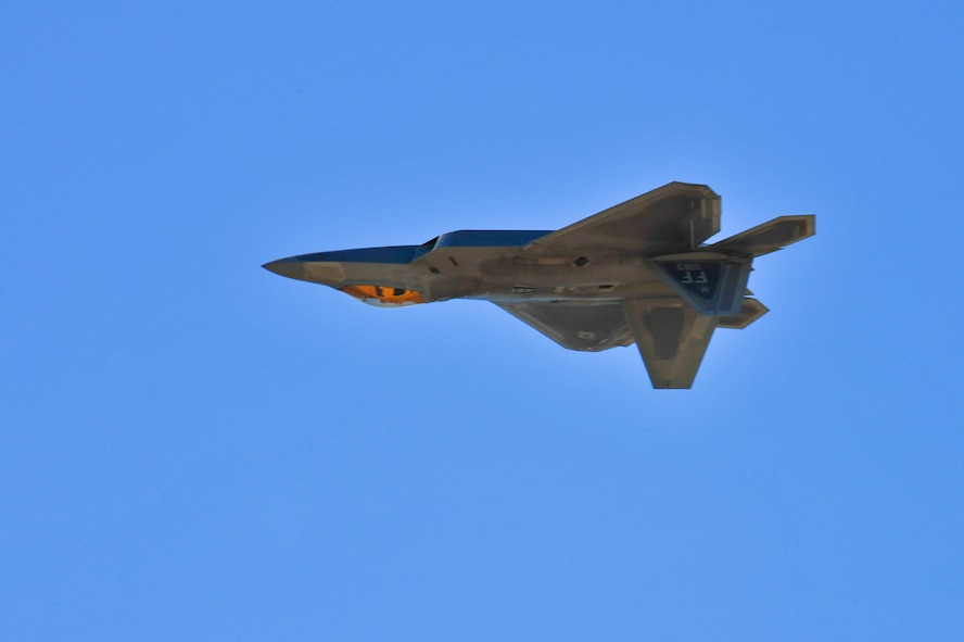 An F-22 Raptor performs an inverted fly-by during the 2015 Heritage Flight Training and Certification Course at Davis-Monthan Air Force Base, Ariz., Feb. 26, 2015. The annual aerial demonstration training event has been held at D-M since 2001, providing civilian and military pilots the opportunity to practice flying in formation for the upcoming air show season. (U.S. Air Force photo by Airman 1st Class Chris Massey/Released)