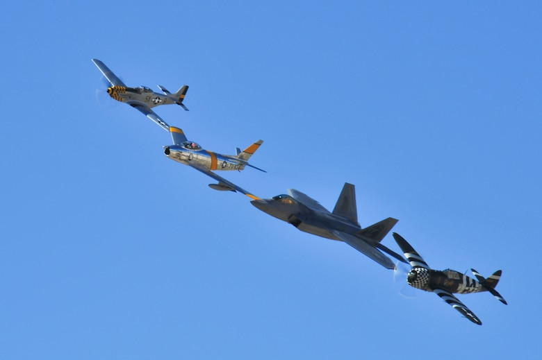 A P-51 Mustang, F-86 Sabre, F-22 Raptor and P-47 Thunderbolt fly in formation during the 2015 Heritage Flight Training and Certification Course at Davis-Monthan Air Force Base, Ariz., Feb. 26, 2015.  The annual aerial demonstration training event has been held at D-M since 2001, providing civilian and military pilots the opportunity to practice flying in formation for the upcoming air show season. (U.S. Air Force photo by Airman 1st Class Chris Massey/Released)