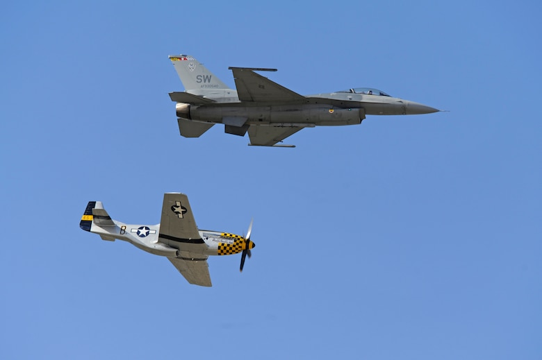 A P-51 Mustang and an F-16 Fighting Falcon practice flying their aerial demonstration during the 2015 Heritage Flight Training and Certification Course at Davis-Monthan Air Force Base, Ariz., Feb. 28, 2015. Established in 1997, the HFTCC featured aerial demonstrations from historical and modern fighter aircraft which will fly in formation together during air shows across the country. (U.S. Air Force photo by Airman 1st Class Betty R. Chevalier)