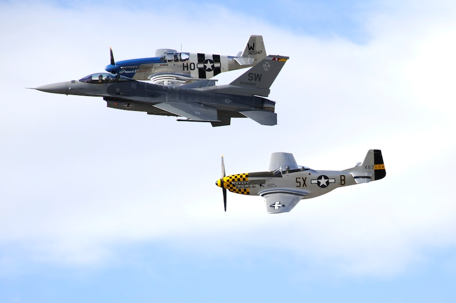 An F-16 Fighting Falcon and two P-51 Mustangs fly in formation together during the 2015 Heritage Flight Training and Certification Course at Davis-Monthan Air Force Base, Ariz., Feb. 28, 2015. The annual aerial demonstration training event has been held at D-M since 2001, providing civilian and military pilots the opportunity to practice flying in formation in for the upcoming air show season. (U.S. Air Force photo by Airman 1st Class Betty R. Chevalier)