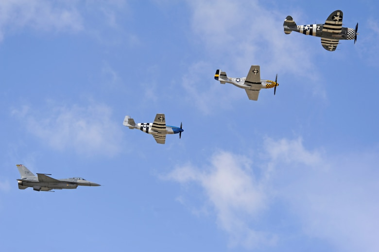 An F-16 Fighting Falcon, two P-51 Mustangs and a P-47 Thunderbolt fly in formation together during the 2015 Heritage Flight Training and Certification Course at Davis-Monthan Air Force Base, Ariz., Feb. 28, 2015. The aircraft that participated in this year's course were the historic P-51 Mustang, P-40 Warhawk, P-38 Lightning, P-47 Thunderbolt, F-86 Sabre, along with the current F-22 Raptor and F-16 Fighting Falcon. (U.S. Air Force photo by Airman 1st Class Betty R. Chevalier)