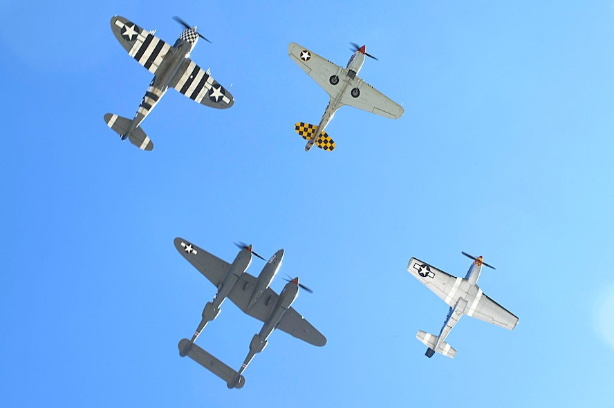 A P-47 Thunderbolt, P-40 Warhawk, P-38 Lightning and P-51 Mustang fly in formation during the 2015 Heritage Flight Training and Certification Course at Davis-Monthan Air Force Base Ariz., March 1, 2015. The annual aerial demonstration training event has been held at D-M since 2001, providing civilian and military pilots the opportunity to practice flying in formation together for the upcoming air show season. (U.S. Air Force photo by Airman 1st Class Chris Drzazgowski/Released)