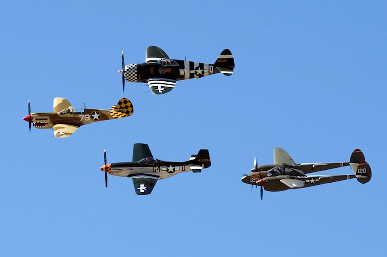 A P-40 Warhawk, P-51 Mustang, P-47 Thunderbolt and P-38 Lightning fly in formation during the 2015 Heritage Flight Training and Certification Course at Davis-Monthan Air Force Base Ariz., March 1, 2015. Established in 1997, the HFTCC featured aerial demonstrations from historical and modern fighter aircraft which will fly in formation together during air shows across the country. (U.S. Air Force photo by Airman 1st Class Chris Drzazgowski/Released)