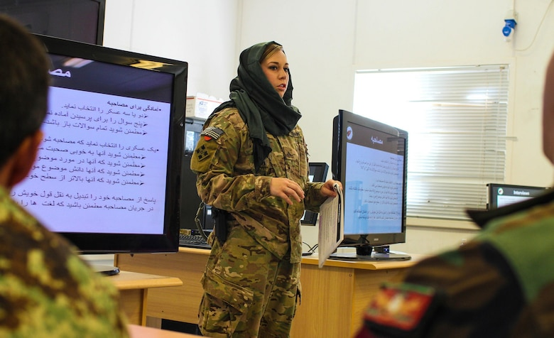 Sgt. Mariah Best of the 70th Mobile Public Affairs Detachment took third-place honors in the Outstanding News Articles category for her article covering International Women's Day in Kandahar, Afghanistan. In this photo, Best teaches a public affairs workshop, instructing the Afghan soldiers how to write a print news article during the deployment. (U.S. Army National Guard photo by Sgt. Clay Beyersdorfer)
