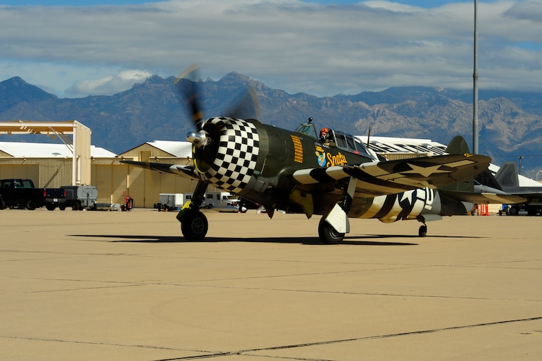 A P-47 Thunderbolt taxis to the runway during the 2015 Heritage Flight Training and Certification Course at Davis-Monthan Air Force Base, Ariz., March 1, 2015. The aircraft that participated in this year's course were the historic P-51 Mustang, P-40 Warhawk, P-38 Lightning, P-47 Thunderbolt, F-86 Sabre, along with the current F-22 Raptor and the F-16 Fighting Falcon. (U.S. Air Force photo by Tech. Sgt. Courtney Richardson/Released)
