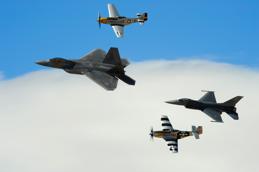 A F-22 Raptor, two P-51 Mustangs and a F-16 Fighting Falcon practice flying in formation during the 2015 Heritage Flight Training and Certification Course at Davis-Monthan Air Force Base, Ariz., March 1, 2015. During the course, aircrews practiced ground and flight training to enable civilian pilots of historic military aircraft and U.S. Air Force pilots of current fighter aircraft to fly safely in formations together. (U.S. Air Force photo by Tech. Sgt. Courtney Richardson/Released)
