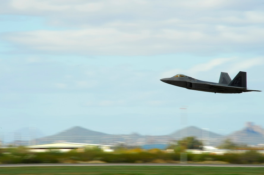 An F-22 Raptor takes off during the 2015 Heritage Flight Training and Certification Course at Davis-Monthan Air Force Base, Ariz., March 1, 2015. Established in 1997, the HFTCC featured aerial demonstrations from historical and modern fighter aircraft which will fly in formation together during air shows across the country. (U.S. Air Force photo by Tech. Sgt. Courtney Richardson/Released)