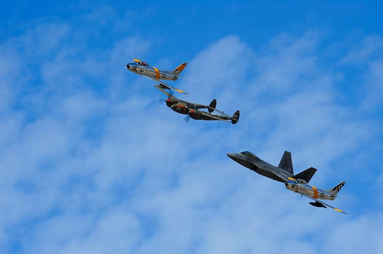 Two F-86 Sabres, a P-38 Lightning and a F-22 Raptor fly in formation together during the 2015 Heritage Flight Training and Certification Course at Davis-Monthan Air Force Base, Ariz., Feb. 28, 2015. The aircraft that participated in this year's course were the historic P-51 Mustang, P-40 Warhawk, P-38 Lightning, P-47 Thunderbolt, F-86 Sabre, along with the current F-22 Raptor and the F-16 Fighting Falcon. (U.S. Air Force photo by Staff Sgt. Courtney Richardson/Released)