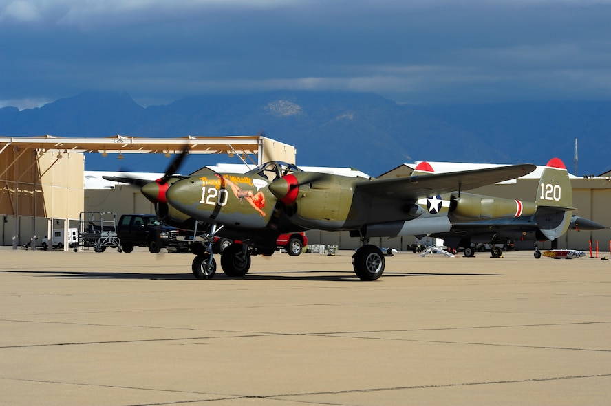 A P-38 Lightning taxis to the runway during the 2015 Heritage Flight Training and Certification Course at Davis-Monthan Air Force Base, Ariz., Feb. 28, 2015. Established in 1997, the HFTCC featured aerial demonstrations from historical and modern fighter aircraft which will fly in formation together during air shows across the country. (U.S. Air Force photo by Staff Sgt. Courtney Richardson/Released)