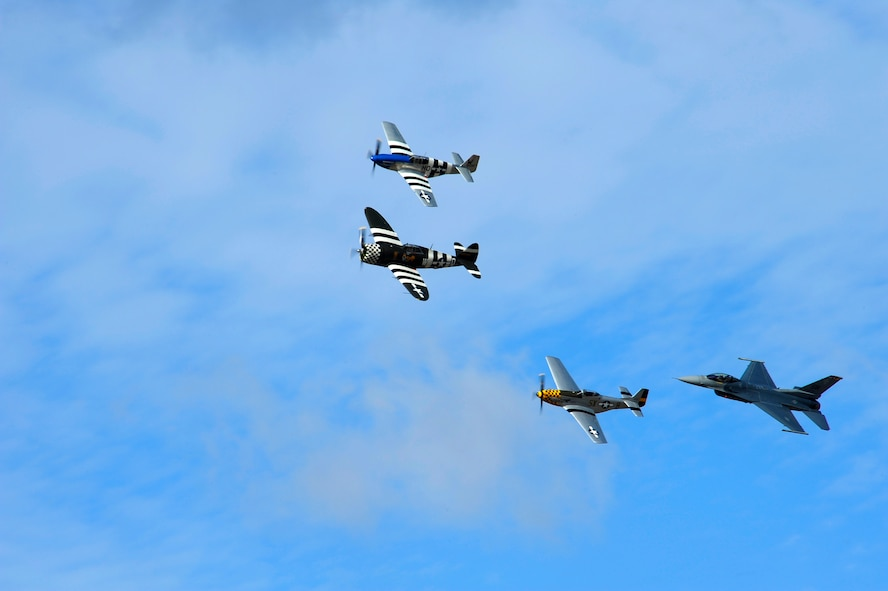 A P-47 Thunderbolt, two P-51 Mustangs and a F-16 Fighting Falcon fly in formation during the 2015 Heritage Flight Training and Certification Course at Davis-Monthan Air Force Base, Ariz., Feb. 28, 2015. Established in 1997, the HFTCC featured aerial demonstrations from historical and modern fighter aircraft which will fly in formation together during air shows across the country. (U.S. Air Force photo by Staff Sgt. Courtney Richardson/Released)