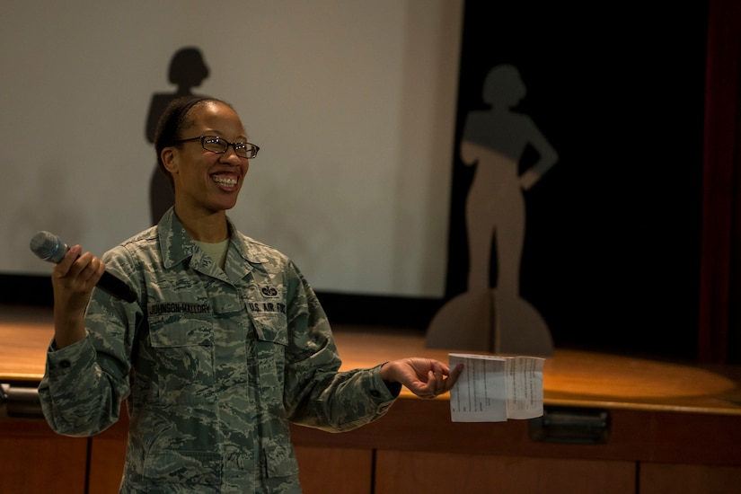 Tech. Sgt. Latoya Johnson-Mallory engages the audience during a 628th Wing Staff Agencies Sexual Assault Prevention event Feb. 26, 2015, at Joint Base Charleston, S.C. The event was held as an open discussion about the differences between restricted and unrestricted reporting of sexual assault cases. During the event a video of the Chief of Staff of the Air Force, Gen. Mark A. Welsh III and Chief Master Sgt. of the Air Force James A. Cody, discussed the importance of Airmen's roles as mandatory reporters of a sexual assault. Johnson-Mallory is a 628th ABW legal office paralegal. (U.S. Air Force photo/Senior Airman Jared Trimarchi)