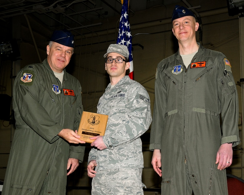 U.S. Air Force Senior Airman Christopher G. Kurtz (center), a cyber-systems operations specialist with the 264th Combat Communications Squadron, receives the 264th CBCS Outstanding Airman of the Year award from Wing Commander Col. William P. Robertson (left) and Wing Vice Commander Lt. Col. Timothy D. Stumbaugh (right) at the 182nd Airlift Wing in Peoria, Ill., Feb. 7, 2015. Kurtz dropped out of high school to enroll in the National Guard Youth ChalleNGe Program in 2008, which inspired a career in the military after graduation. (U.S. Air National Guard photo by Tech. Sgt. Todd A. Pendleton/Released)