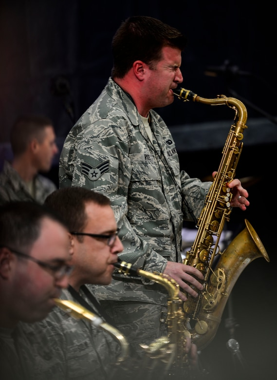 """U.S. Air Force Senior Airman Stephen Rozek, U.S. Air Force Heritage of America Band musician, performs alongside the HOAB """"Rhythm in Blue"""" jazz ensemble during a good-will tour for Harry Connick Jr., musician, actor and """"American Idol"""" judge, and his band at Langley Air Force Base, Va., Feb. 23, 2015. After the ensemble's performance, Connick Jr. and his band played, then shared their experiences as touring musicians. (U.S. Air Force photo by Senior Airman Kayla Newman/Released)"""