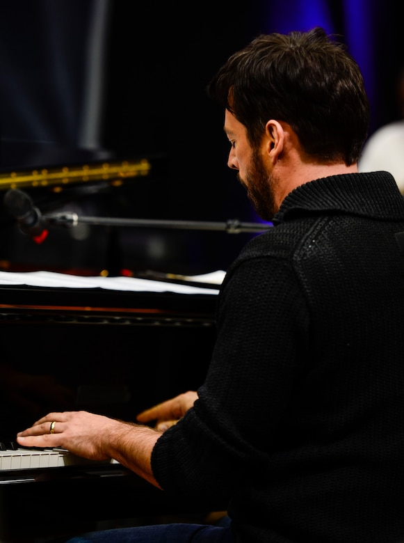 """Harry Connick Jr., musician, actor and """"American Idol"""" judge, and his band perform for U.S. Air Force, Army and Navy Service member-musicians during a visit to Langley Air Force Base, Va., Feb. 23, 2015. During the visit Connick Jr. listened and gave constructive critiques to the U.S. Air Force Heritage of America """"Rhythm in Blue"""" jazz ensemble members and answered questions from the audience. (U.S. Air Force photo by Senior Airman Kayla Newman/Released)"""