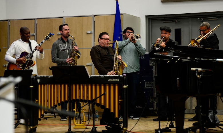 """Members of the """"Harry Connick Jr. Big Band"""" perform for U.S. Air Force, Army and Navy Service member-musicians during a visit to Langley Air Force Base, Va., Feb. 23, 2015. The U.S. Air Force Heritage of America Band """"Rhythm in Blue"""" ensemble hosted Connick Jr. and his band as part of a good-will tour of the base. (U.S. Air Force photo by Senior Airman Kayla Newman/Released)"""