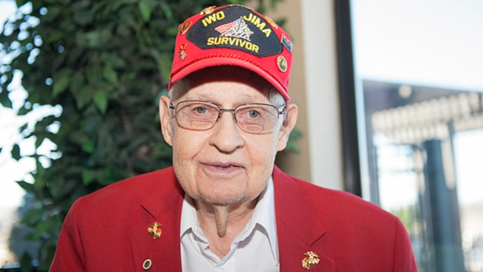 "William ""Bill"" Schott, a Marine veteran and survivor from the battle of Iwo Jima, poses for a photo at the Iwo Jima Battle Survivors and Family Association 70th anniversary reunion in Wichita Falls, Texas, February 14, 2015. Schott served in the Marine Corps from 1943 to 1947."