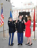 U.S. Army Corps of Engineers' Philadelphia District Deputy Commander Andrew Yoder was promoted to the rank of Lieutenant Colonel during a March 4, 2015 ceremony at the Liberty Bell. Col. Marc Ferraro (left), Acting Deputy Adjutant General of the Pennsylvania National Guard, and Yoder's wife, Nikki, pinned the rank on LTC Yoder.