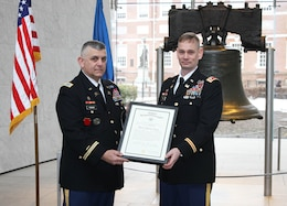 Col. Marc Ferraro (left), Acting Deputy Adjutant General of the Pennsylvania National Guard, pinned the rank of Lieutenant Colonel on Andrew Yoder (right) during a March 4, 2015 ceremony at the Liberty Bell. Yoder serves as the deputy commander of the U.S. Army Corps of Engineers Philadelphia District.