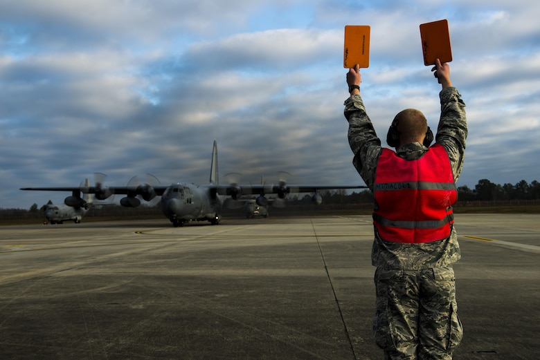 Airman 1st Class Cameron Miller marshals aircraft 62-1863 'Iron Horse', an HC-130P Combat King, before takeoff Mar. 3, 2015, at Moody Air Force Base, Ga. Iron Horse has been stationed at Moody AFB since 2007 and is being flown to Davis-Monthan AFB, Ariz., for retirement. Miller is a 71st Aircraft Maintenance Unit crew chief. (U.S. Air Force photo/Airman 1st Class Dillian Bamman)
