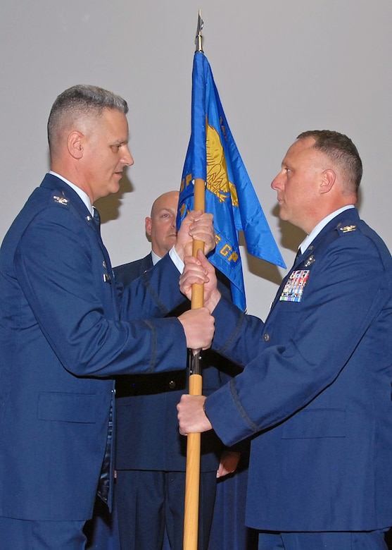 Colonel Joseph Francoeur assumes command of the 143d Airlift Wing Operations Group by receiving the guidon from Colonel Arthur Floru, Commander, 143d AW, at a ceremony held at Quonset Air National Guard Base, North Kingstown, Rhode Island on February 8, 2015. Colonel Francoeur is replacing Colonel John Sullivan who has taken a position at Joint Force Headquarters-RI. National Guard Photo by Technical Sgt Jason Long (RELEASED)