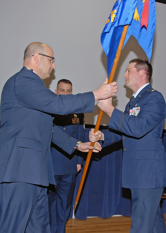 Major Jeremiah Buckenberger (right) assumes Command of the 143d Civil Engineering Squadron from Colonel Anthony Hamel, 143d Airlift Wing, Mission Support Group Commander during a ceremony held at Quonset Air National Guard Base, North Kingstown, Rhode Island on February 8, 2015. Outgoing 143d CES Commander, Lieutenant Colonel Kevin Bartlett, retired from the 143d Airlift Wing on February 7, 2015. National Guard Photo by Technical Sgt Jason Long (RELEASED)