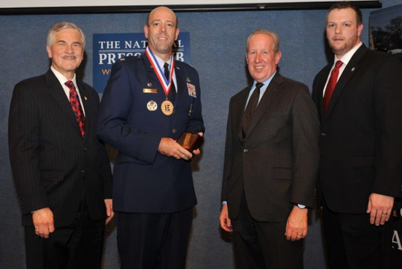 The National Society of Professional Engineers named Lt. Col. Patrick Miller, 628th Civil Engineer Squadron commander, as the nation's top federal engineer during a ceremony Feb. 26, 2015 at the National Press Club in Washington, D.C.Standing (Left to right): NSPE President Harve D. Hnatiuk, P.E., F.NSPE; Lt. Col. Patrick Miller, P.E., U.S. Air Force; NSPE Executive Director Mark J. Golden, FASAE, CAE; and NSPE Board Member David Scott Wolf, P.E., PLS, F.NSPE. (Courtesy Photo / Christies Photography)