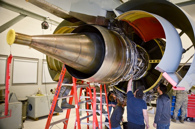 Airmen with the propulsion shop at the 128th Air Refueling Wing, Wisconsin Air National Guard, and students with the Milwaukee Area Technical College train on the F108 turbofan engine Feb. 25.  (U.S. Air National Guard photo by Tech. Sgt. Jenna Lenski/Released)