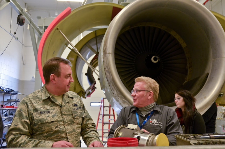 Senior Master Sgt. Michael Nuoffer, the propulsion shop supervisor with the 128th Air Refueling Wing, Wisconsin Air National Guard, discusses aviation with Scott Garland, the instructor of aeronautics at Milwaukee Area Technical College Feb. 25 here.  (U.S. Air National Guard photo by Tech. Sgt. Jenna Lenski/Released)