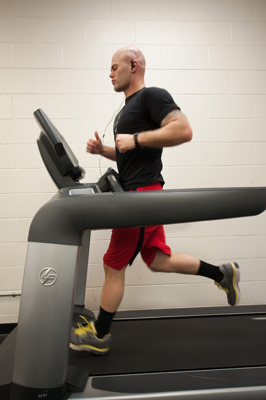 Senior Airman Shane Phipps, 30th Space Wing Public Affairs photojournalist, runs on a treadmill, March 4, 2015, Vandenberg Air Force Base, Calif. Since March is National Nutrition Month, members of the armed forces are provided an opportunity to assess their current fitness levels. (U.S. Air Force photo by Michael Peterson/Released)