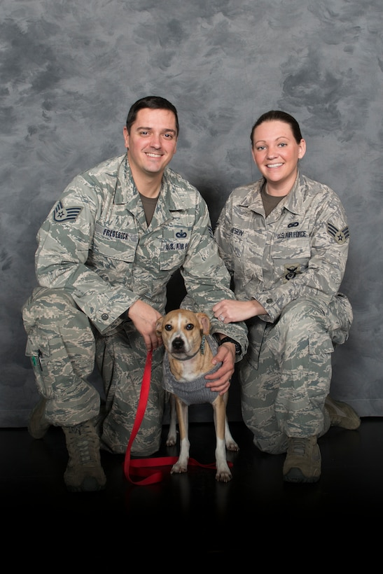 U.S. Air Force Senior Airman Tara Thompson, right, 23d Security Forces Squadron confinement officer, and Staff Sgt. Ryan Frederick, 23d SFS military working dog instructor, pose with their rescue dog Apollo Jan. 30, 2015, at Moody Air Force Base, Ga. In addition to Apollo, Thompson and Frederick own another rescue dog, Atticus, and a retired military working dog, Rico. (U.S. Air Force photo by Airman 1st Class Dillian Bamman/Released)