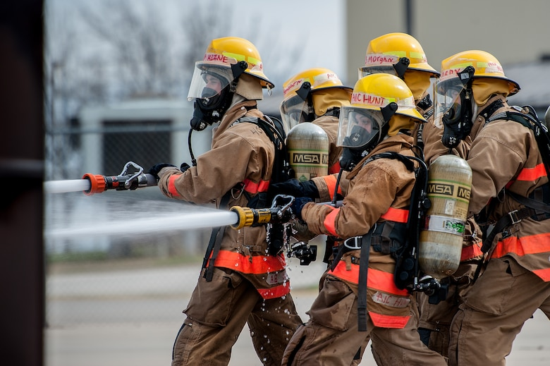 GOODFELLOW AIR FORCE BASE, Texas – Airman 1st Class Brooke D. Hunt, 177th Fighter Wing New Jersey Air National Guard firefighter apprentice, and her classmates spray fire hoses at the Louis F. Garland Department of Defense Fire Academy Feb. 3. Hunt is the only female firefighter in her class. (U.S. Air Force photo/ Airman 1st Class Devin Boyer)