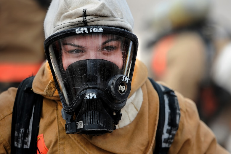 GOODFELLOW AIR FORCE BASE, Texas – Airman 1st Class Brooke D. Hunt, 177th Fighter Wing New Jersey Air National Guard firefighter apprentice, wears fire protection gear at the Louis F. Garland Department of Defense Fire Academy Feb. 3. Hunt is a student of the Fire Protection Apprentice Course at the fire academy. (U.S. Air Force photo/ Airman 1st Class Devin Boyer)