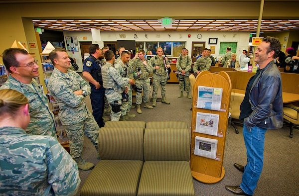 "Actor and USO tour veteran Vince Vaughn, far right, answers service members' questions in the base library at Edwards Air Force Base, Calif., Feb. 28, 2015. Vaughn treated troops and their families to an advance screening of his upcoming film, ""Unfinished Business"" during his USO visit to the base. USO photo by Dave Gatley"