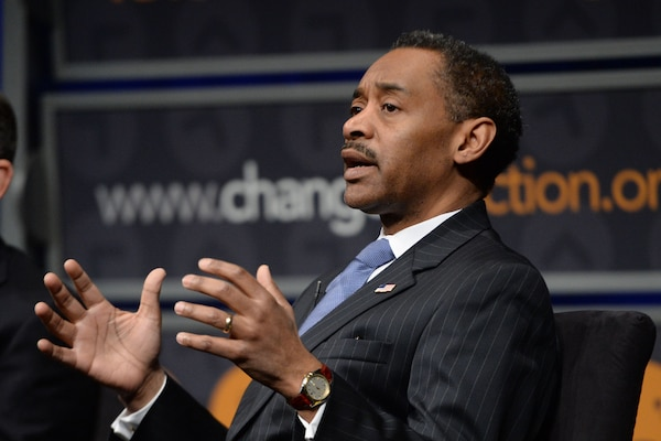 Assistant Defense Secretary for Health Affairs Jonathan Woodson discusses mental health concerns among veterans during a symposium at the Newseum in Washington, D.C., March 4, 2015. DoD photo by EJ Hersom